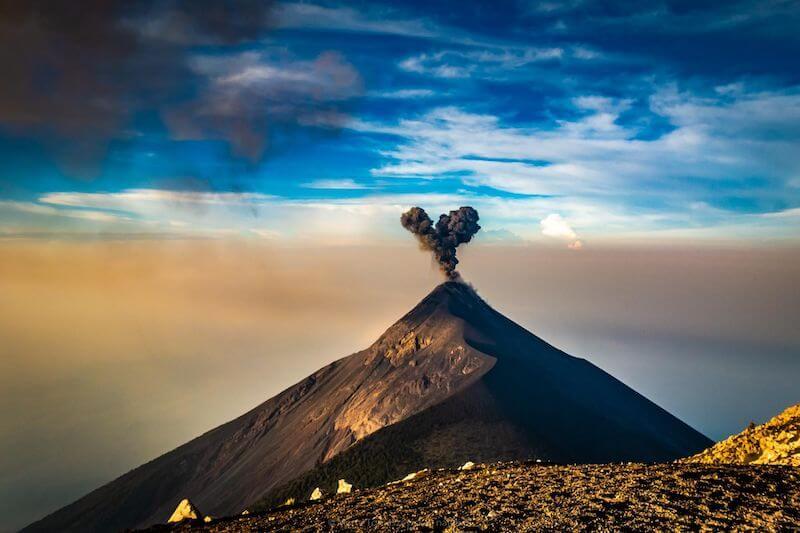 Volcano de Fuego erupting during sunrise.